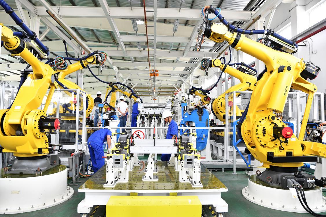 整车试制中心-FDS自适应热熔紧固系统和SPR自冲铆接系统机器人岛